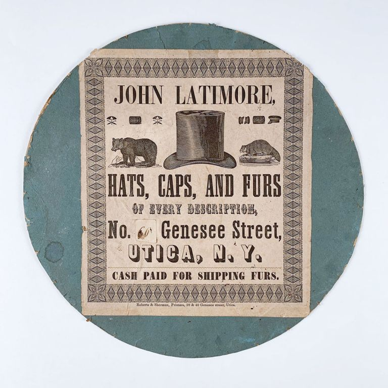 John Latimore, Hats, Caps, and Furs of Every Description, No. 60 Genesee Street, Utica, N.Y. Cash Paid for Shipping Furs.
