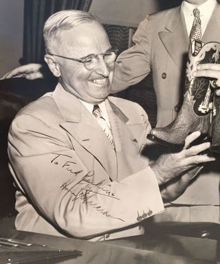 [President Harry Truman Receives a Gift of Cowboy Boots].