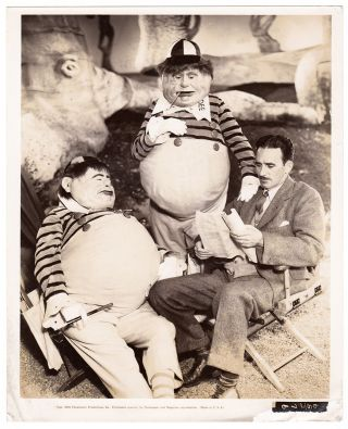 [Promotional photos for an Alice in Wonderland movie].